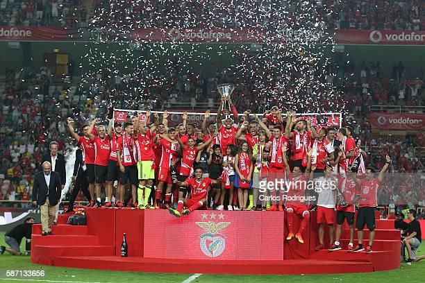 Benfica«s players receiving the Super Cup trophy after the match between SL Benfica v SC Braga for Portuguese Super Cup at Estadio Municipal de...