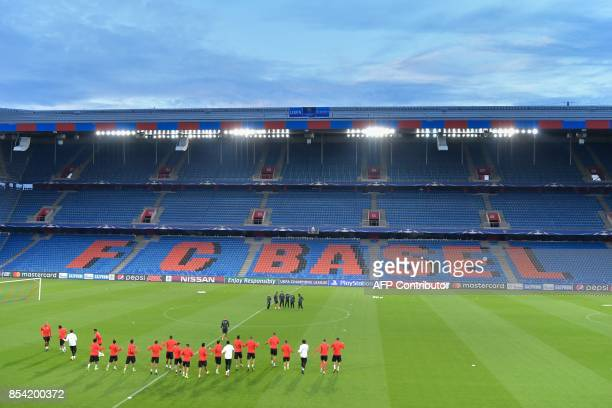 Benfica's players wamr up during a training session on the eve of the UEFA Champions league Group A football match between FC Basel 1893 and SL...