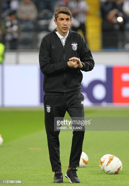 Benfica's Portuguese coach Bruno Lage observes the warm up session prior to the UEFA Europa League quarterfinal second leg football match Eintracht...