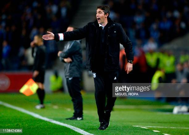 Benfica's Portuguese coach Bruno Lage shouts instructions during the Portuguese League football match between FC Porto and SL Benfica at the Dragao...
