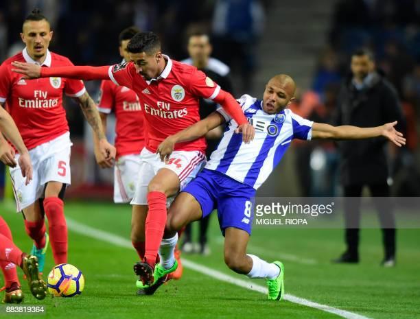 Benfica's Portuguese defender Andre Almeida vies with Porto's Algerian forward Yacine Brahimi during the Portuguese league football match FC Porto vs...