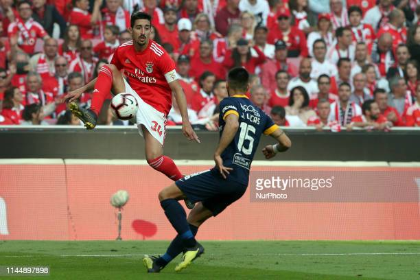 Benfica's Portuguese defender Andre Almeida vies with Santa Clara's defender Joao Lucas during the Portuguese League - Primeira Liga - football match...