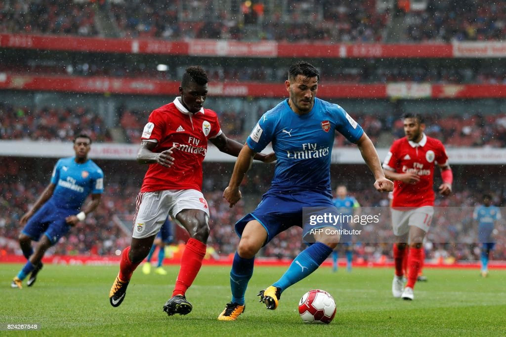 Benfica's Portuguese defender Aurelio Buta (L) chases Arsenal's German-born Bosnian defender Sead Kolasinac (R) during the pre-season friendly football match between Arsenal and Benfica at The Emirates Stadium in north London on July 29, 2017, the game is one of four matches played over two days for the Emirates Cup. / AFP PHOTO / Ian KINGTON / RESTRICTED TO EDITORIAL USE. No use with unauthorized audio, video, data, fixture lists, club/league logos or 'live' services. Online in-match use limited to 75 images, no video emulation. No use in betting, games or single club/league/player publications. /