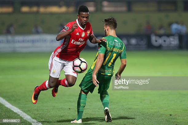Benfica's Portuguese defender Nelson Semedo in action with Tondela's Portuguese forward Miguel Cardoso during the Premier League 2016/17 match...