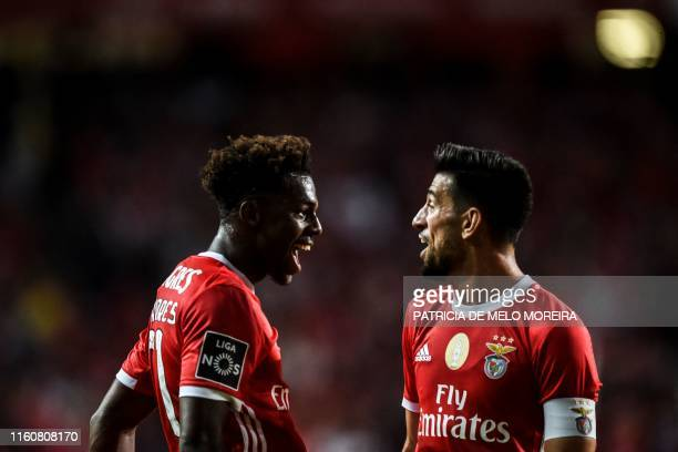Benfica's Portuguese defender Nuno Tavares celebrates his goal with teammate Portuguese midfielder Pizzi Fernandes during the Portuguese league...
