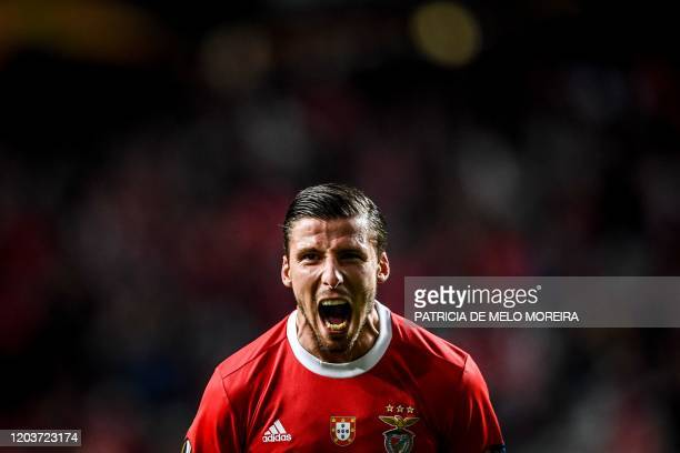 Benfica's Portuguese defender Ruben Dias celebrates after scoring during the UEFA Europa League round of 32 second leg football match between SL...