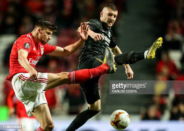 Benfica's Portuguese defender Ruben Dias vies with Frankfurt's Croatian midfielder Ante Rebic during the UEFA Europa league quarter final first leg...