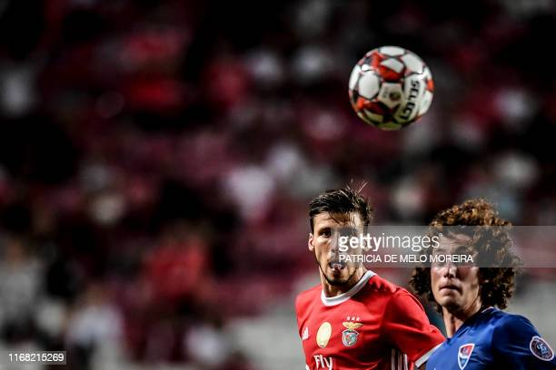 Benfica's Portuguese defender Ruben Dias vies with Gil Vicente's Bulgarian midfielder Bozhidar Kraev during the Portuguese League football match...