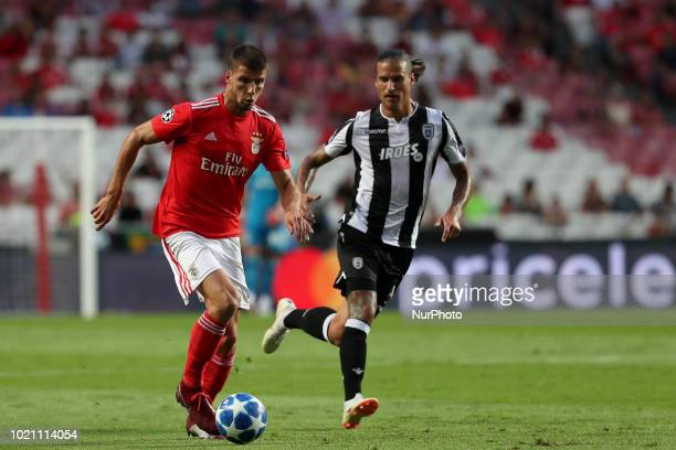 Benfica's Portuguese defender Ruben Dias vies with PAOK's forward Aleksandar Prijovic from Serbia during the UEFA Champions League playoff first leg...