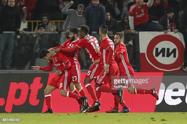 Benfica's Portuguese forward Goncalo Guedes celebrates after scoring goal with teammates during the League Cup 2016/17 match between Vitoria SC and...