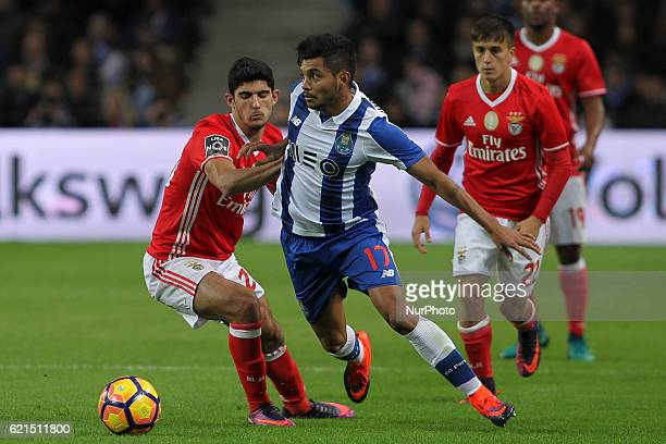 Benfica's Portuguese forward Goncalo Guedes with Porto's Mexican forward Jesus Corona during the Premier League 2016/17 match between FC Porto and SL...
