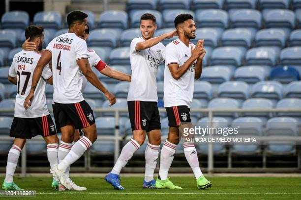 Benfica's Portuguese forward Goncalo Ramos celebrates with teammates after scoring a goal during an international club friendly football match...