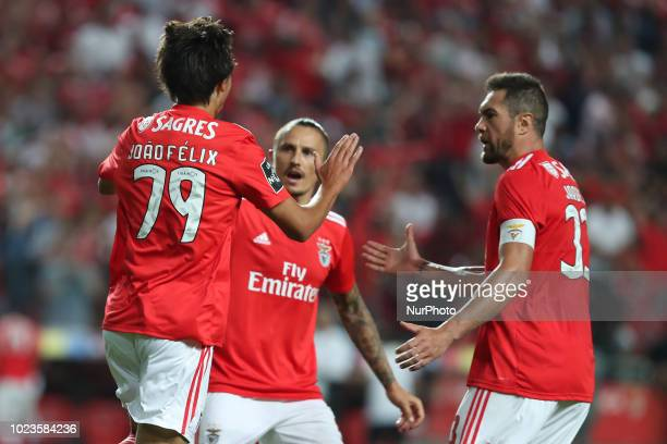 Benfica's Portuguese forward Joao Felix celebrates with teammates after scoring during the Portuguese League football match SL Benfica vs Sporting CP...