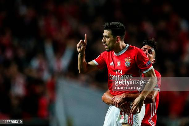 Benfica's Portuguese forward Pizzi celebrates with Benfica's Spanish midfielder Gabriel Appelt after scoring a goal during the UEFA Champions League...