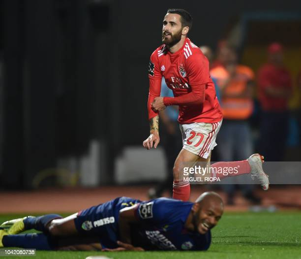Benfica's Portuguese forward Rafa Silva celebrates his goal past Chaves' Brazilian defender Marcao during the Portuguese league footbal match between...