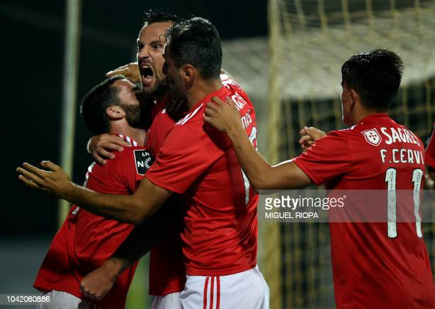 Benfica's Portuguese forward Rafa Silva celebrates his goal with teammates Swiss forward Haris Seferovic Brazilian forward Jonas and Argentinian...