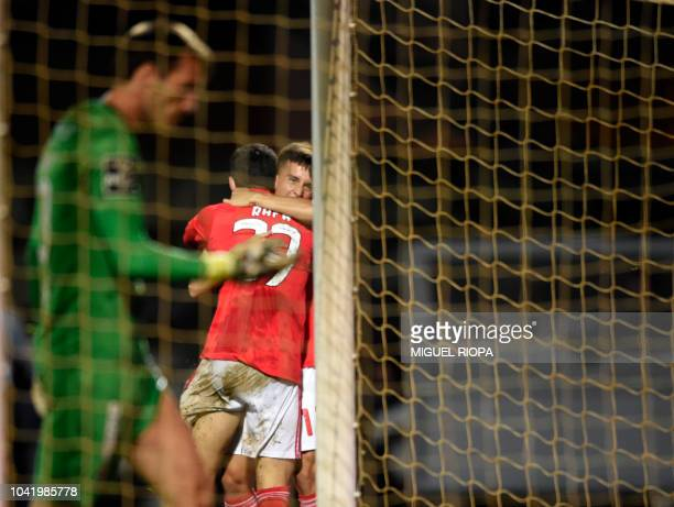 Benfica's Portuguese forward Rafa Silva celebrates with teammate Benfica's Argentinian forward Franco Cervi after scoring a goal during the...