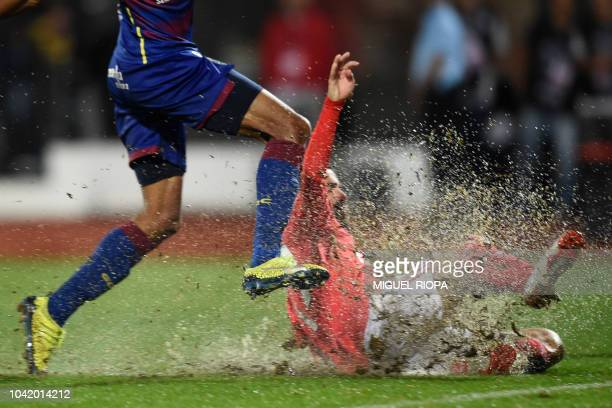 Benfica's Portuguese forward Rafa Silva falls on the field after scoring a goal during the Portuguese league footbal match between GD Chaves and SL...