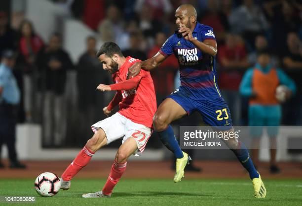 Benfica's Portuguese forward Rafa Silva shoots to score a goal beside Chaves' Brazilian defender Marcao during the Portuguese league footbal match...