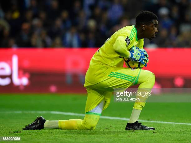 Benfica's Portuguese goalkeeper Bruno Varela kneels on the field during the Portuguese league football match FC Porto vs SL Benfica at the Dragao...