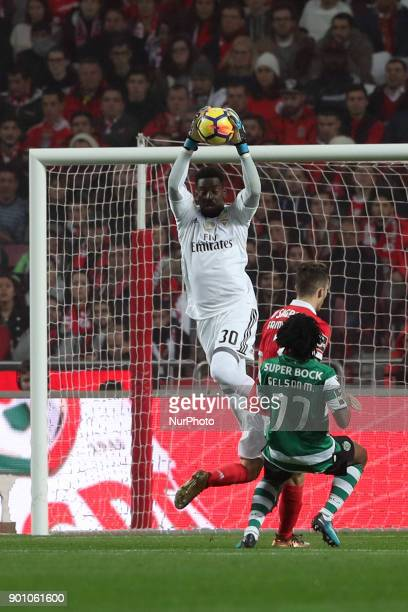 Benfica's Portuguese goalkeeper Bruno Varela makes a safe during the Portuguese League football match SL Benfica vs Sporting CP at the Luz stadium in...