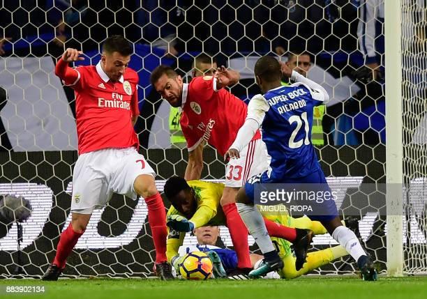 Benfica's Portuguese goalkeeper Bruno Varela saves the ball beside Porto's Portuguese defender Ricardo Pereira during the Portuguese league football...