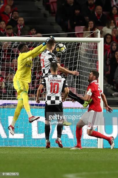 Benfica's Portuguese goalkeeper Bruno Varela vies with Boavista's defender Nuno Henrique during the Portuguese League football match SL Benfica vs...