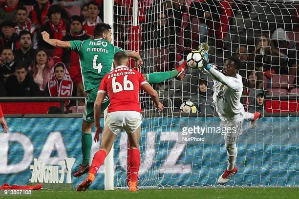Benfica's Portuguese goalkeeper Bruno Varela vies with Rio Ave's defender Nelson Monte during the Portuguese League football match SL Benfica vs Rio...