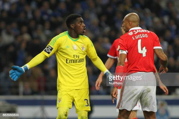 Benfica's Portuguese goalkeeper Bruno Varela with Benfica's Brazilian defender Luisao during the Premier League 2016/17 match between FC Porto and SL...