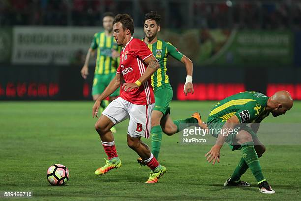 Benfica's Portuguese midfielder Andre Horta in action with Tondela's Portuguese defender Joao Pica during the Premier League 2016/17 match between CD...