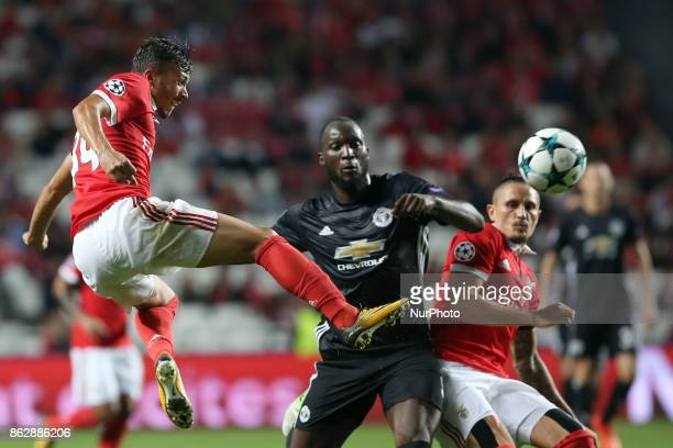 Benfica's Portuguese midfielder Diogo Goncalves fights for the ball with Manchester United's Belgian forward Romelu Lukaku during the UEFA Champions...