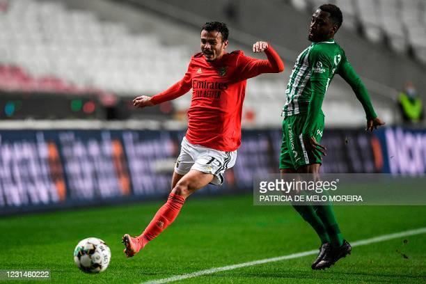 Benfica's Portuguese midfielder Diogo Gonclaves challenges Rio Ave's Brazilian defender Savio Alves during the Portuguese league football match...