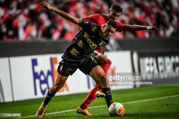 Benfica's Portuguese midfielder Diogo Gonclaves challenges Standard Liege's Belgian midfielder Selim Amallah during the UEFA Europa League group D...