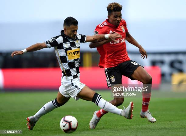Benfica's Portuguese midfielder Gedson Fernandes challenges Boavista's Portuguese midfielder Carraca during the Portuguese league football match...