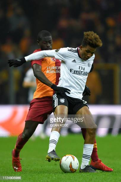 Benfica's Portuguese midfielder Gedson Fernandes fights for the ball with Galatasaray's Senegalese midfielder Papa Alioune Ndiaye during the UEFA...
