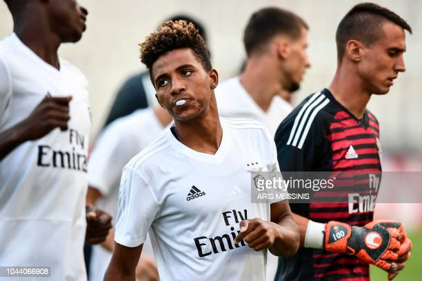 Benfica's Portuguese midfielder Gedson Fernandes jogs with teammates during a training session at the Athens' Olympic Stadium on October 1 2018 on...