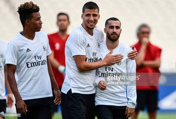 Benfica's Portuguese midfielder Gedson Fernandes looks at Benfica's Portuguese defender Ruben Dias and Benfica's Portuguese forward Rafa Silva...