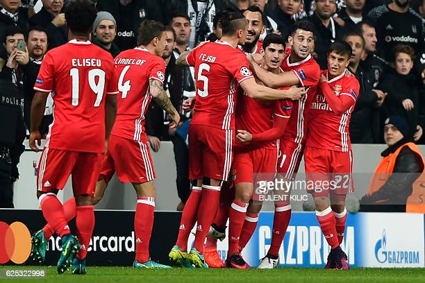 Benfica's Portuguese midfielder Goncalo Guedes celebrateswith teammates after scoring a goal during the UEFA Champions League group B football match...