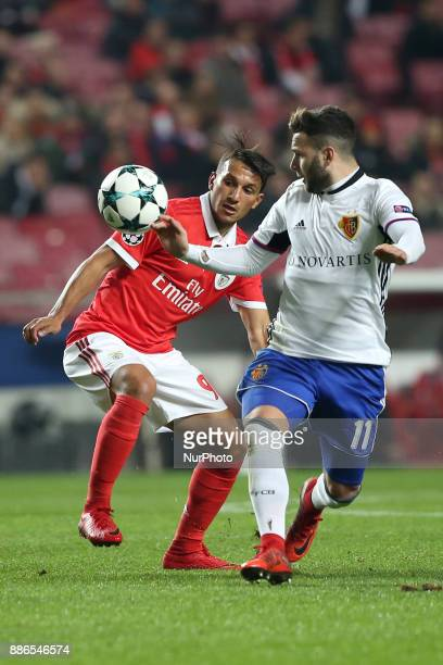 Benfica's Portuguese midfielder Joao Carvalho vies with Basel's midfielder Renato Steffen from Suisse during the UEFA Champions League Group A...