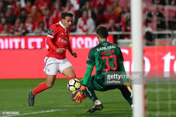 Benfica's Portuguese midfielder Joao Carvalho vies with Boavista's goalkeeper Vagner during the Portuguese League football match SL Benfica vs...