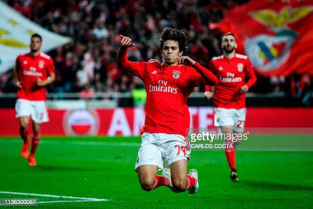 Benfica's Portuguese midfielder Joao Felix celebrates after scoring a goal during the UEFA Europa league quarter final first leg football match...