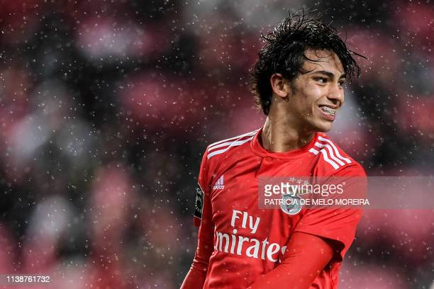 Benfica's Portuguese midfielder Joao Felix smiles during the Portuguese League football match between SL Benfica and CS Maritimo at the Luz stadium...