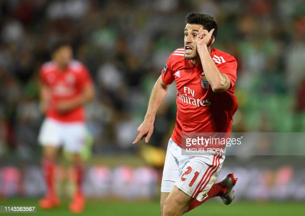 Benfica's Portuguese midfielder Pizzi celebrates after scoring a goal during the Portuguese league football match Rio Ave FC vs SL Benfica at the Dos...