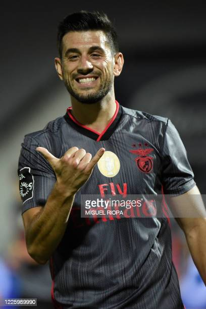 Benfica's Portuguese midfielder Pizzi celebrates after scoring a goal during the Portuguese League football match between Famalicao and Benfica at...