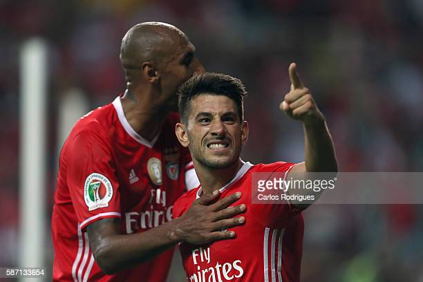 Benfica's Portuguese midfielder Pizzi celebrates Benfica«s second goal with Benfica's Brazilian defender Luisao scored by Benfica's Brazilian forward...