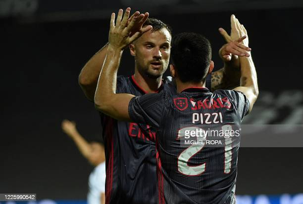 Benfica's Portuguese midfielder Pizzi celebrates with Benfica's Swiss forward Haris Seferovic during the Portuguese League football match between...