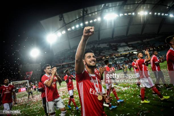 Benfica's Portuguese midfielder Pizzi Fernandes and teammates celebrate winning the Portugal's Super Cup final football match between SL Benfica and...