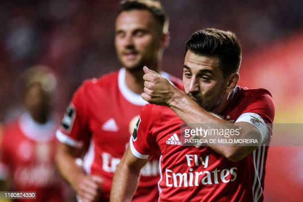 Benfica's Portuguese midfielder Pizzi Fernandes celebrates a goal during the Portuguese league football match between SL Benfica and FC Pacos de...