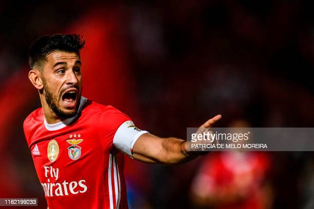 Benfica's Portuguese midfielder Pizzi Fernandes celebrates after scoring a goal during the Portuguese League football match between Belenenses and...
