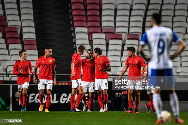 Benfica's Portuguese midfielder Pizzi Fernandes celebrates his goal with teammates during the UEFA Europa League group D football match between...